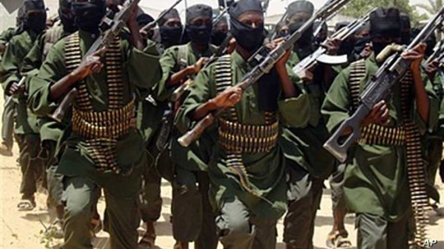 Al-Shabab fighters march with their guns during military exercises on the outskirts of Mogadishu, Somalia, February 17, 2011