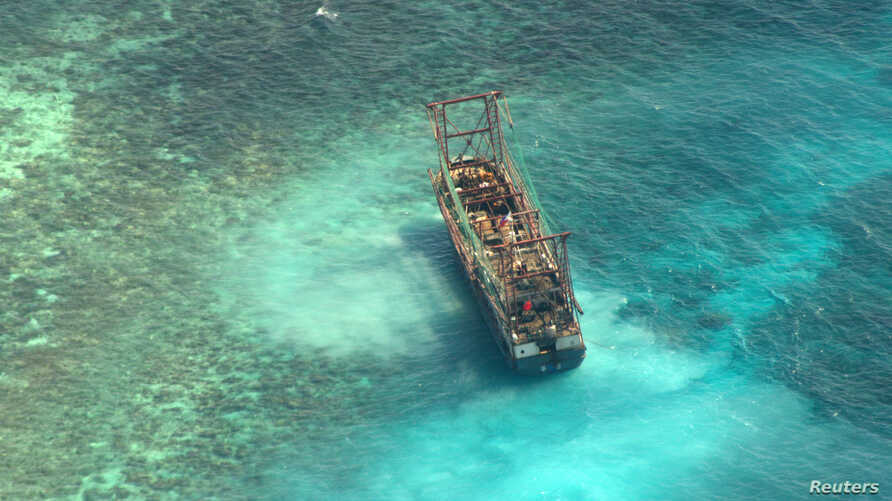 A Chinese fishing vessel that ran aground in Tubbataha Reef, a UNESCO World Heritage site, on Monday is pictured in Palawan Province, west of Manila April 10, 2013.
