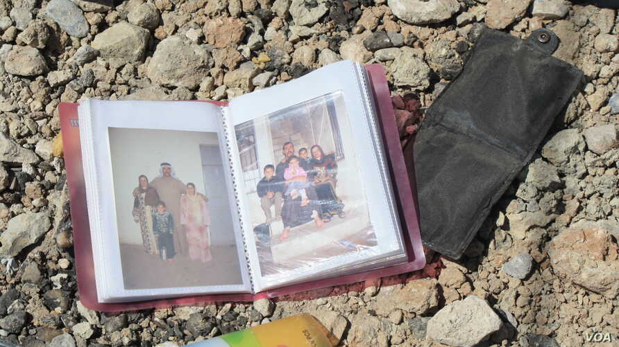 An family photo album lies among debris and blood where civilians were shot down by Islamic State snipers in early June, in Mosul, Iraq, June 15, 2017.