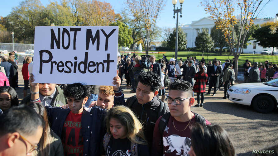 A group of protesters gather outside of the White House after U.S. President-elect Donald Trump met with U.S. President Barack Obama at White House in Washington, Nov. 10, 2016.