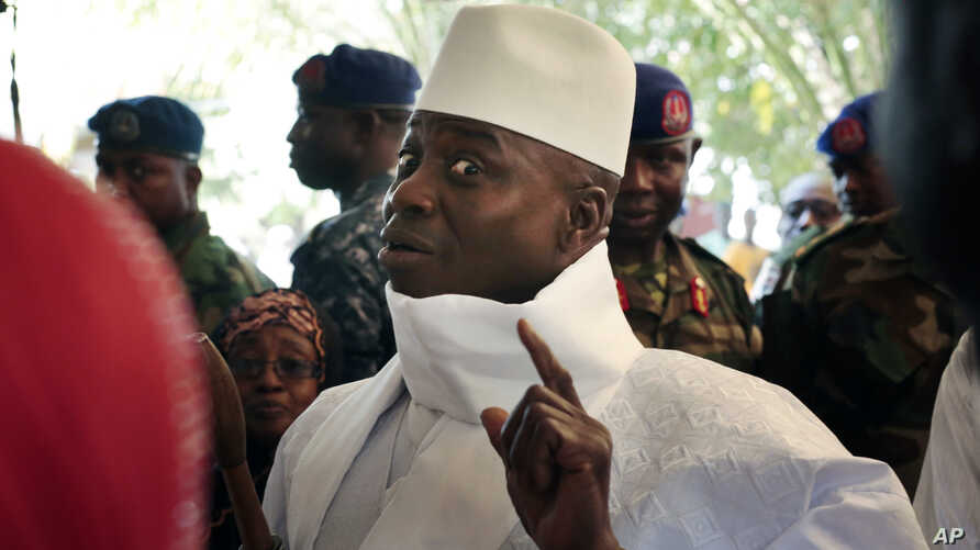 In a Thursday, Dec. 1, 2016 file photo, Gambia's president Yahya Jammeh shows his inked finger before voting in Banjul, Gambia.