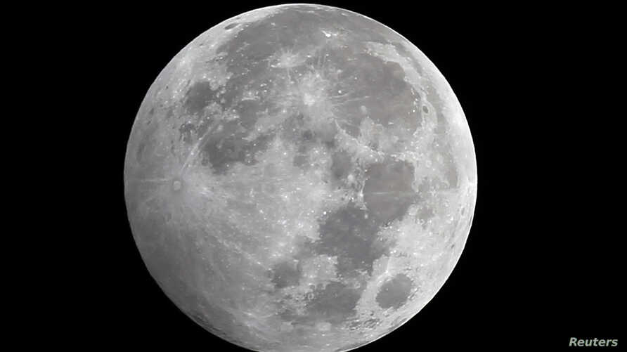 The Earth (unseen) casts a faint shadow over the southwestern part of a full moon during the penumbral lunar eclipse in Cairo October 19, 2013. A penumbral lunar eclipse occurs when the moon crosses the Earth's shadow, causing a slight dimming on the