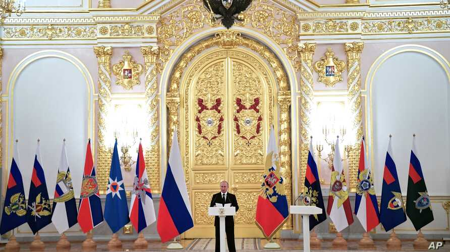 Russian President Vladimir Putin speaks as he meets with top military officers and law enforcement officials in the Kremlin, in Moscow, Russia, Oct. 25, 2018.