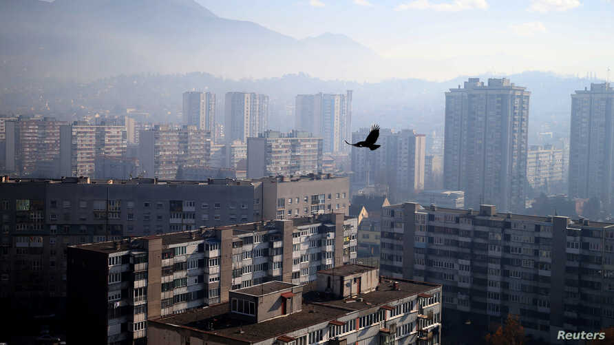 FILE - General view of the city as smog blankets Sarajevo, Bosnia and Herzegovina.
