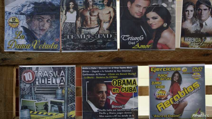 A DVD production called Obama in Cuba is displayed for sale alongside pirated CDs in Havana, April 15, 2016.