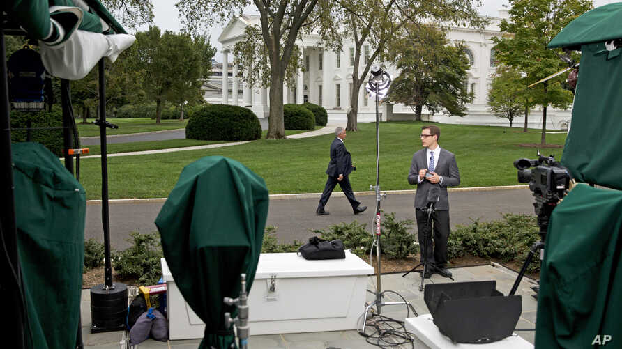 Members of the media by the White House in Washington, Sept. 29, 2014.