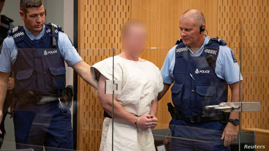 Brenton Tarrant, charged for murder in relation to the mosque attacks, is lead into the dock for his appearance in the Christchurch District Court, New Zealand, March 16, 2019. (Suspect's face blurred at source)