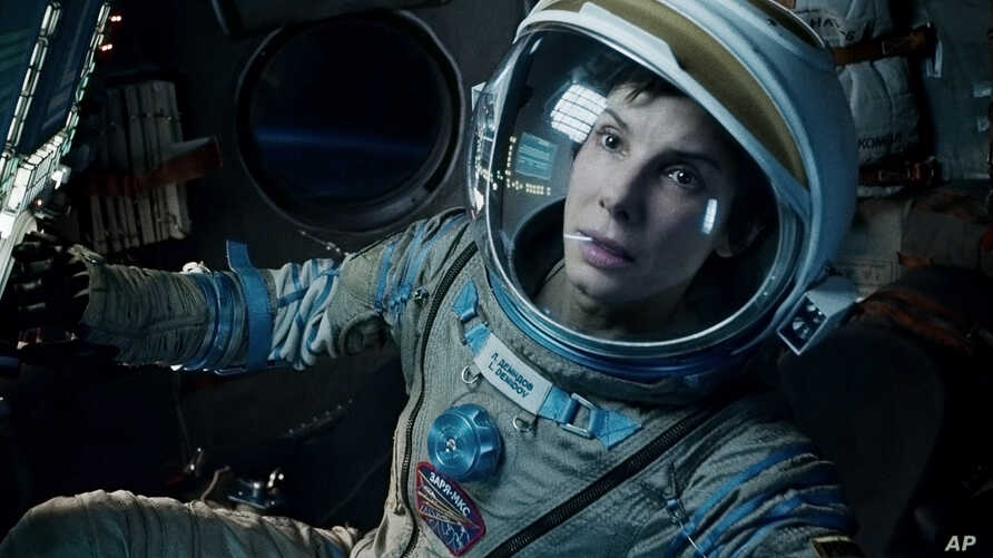 """This film image released by Warner Bros. Pictures shows Sandra Bullock in a scene from """"Gravity."""" Bullock says making the lost-in-space movie directed by Alfonso Cuaron was her """"best life decision"""" ever."""
