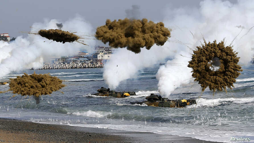 Amphibious assault vehicles of the South Korean Marine Corps throw smoke bombs as they move to land on shore during a U.S.-South Korea joint landing operation drill in Pohang, South Korea, March 31, 2014.