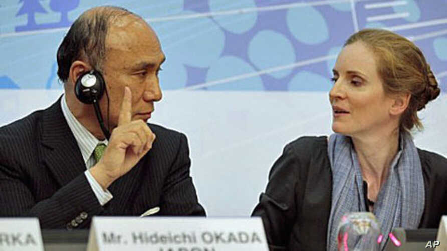 Vice Minister for International Affairs of the Ministry of Economics, Trade and Industry of Japan Hideichi Okada (L) is flanked by France's Environment and Transport minister, Nathalie Kosciusko-Morizet, as he speaks about nuclear energy safety durin