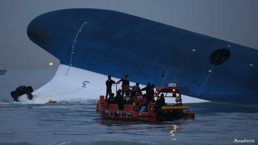 Maritime police search for missing passengers in front of the South Korean ferry that sank near Jindo, South Korea, April 16, 2014.