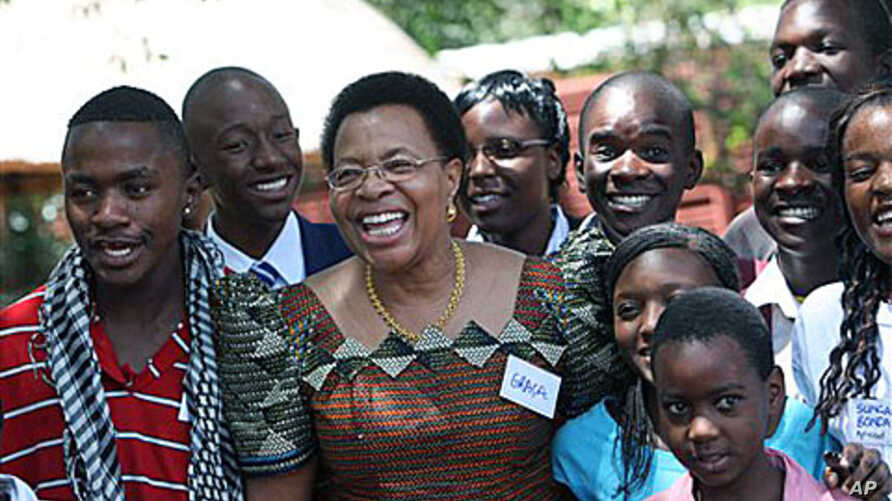 Graca Machel, wife of  Nelson Mandela, poses for a photo with children , during her visit in Harare. Machel  is in Zimbabwe to show support for the Inclusive Government in particular its efforts to uphold the rights of its children in the areas of ed