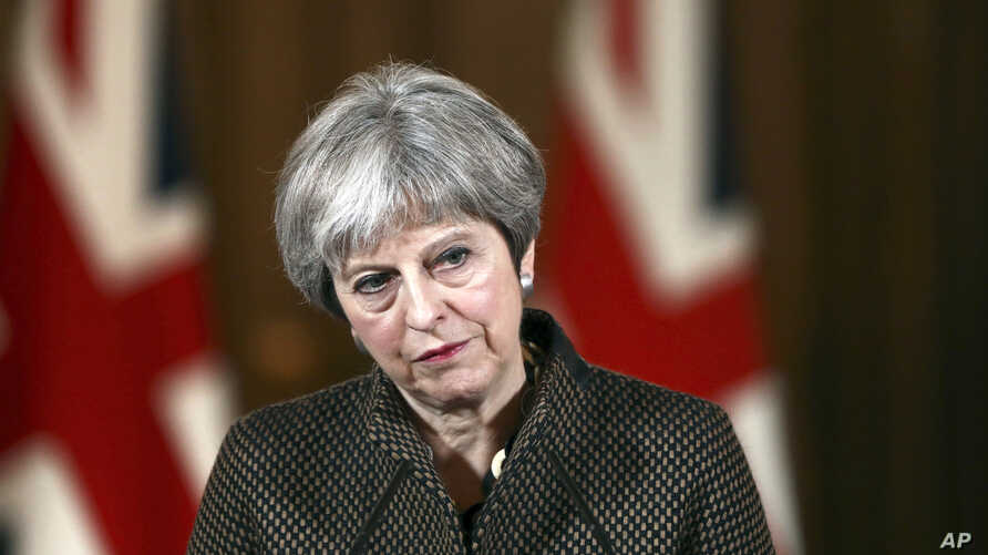 """Britain's Prime Minister Theresa May during a press conference in 10 Downing Street, London, April 14, 2018. May says the need to act quickly and protect """"operational security"""" led her to strike Syria without a prior vote in Parliament."""