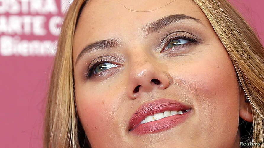 """Actress Scarlett Johansson poses during a photocall for the movie """"Under the Skin"""", directed by Jonathan Glazer, during the 70th Venice Film Festival in Venice Sept. 3, 2013."""