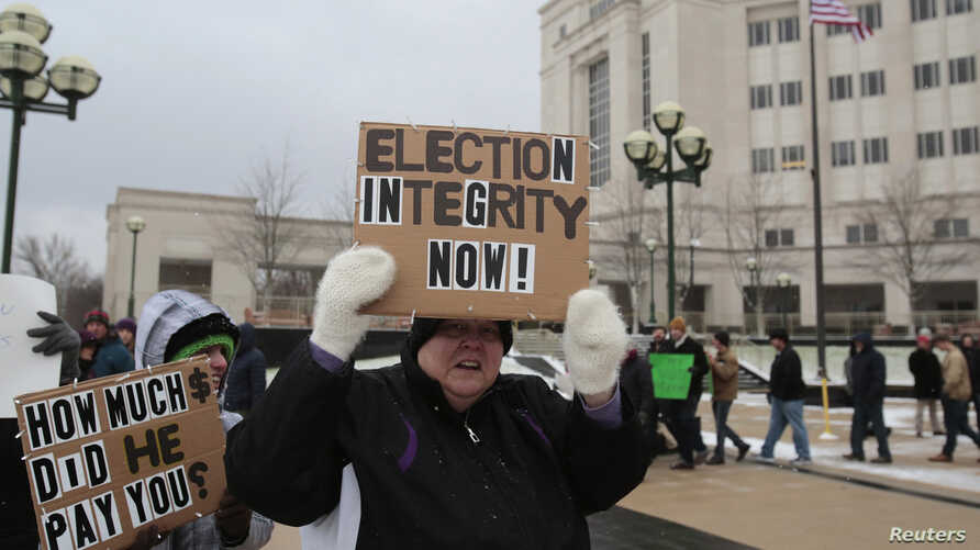 Members of the Green Party rally in support of continuing the recount of the U.S. presidential ballots in Lansing, Mich., Dec. 8, 2016.