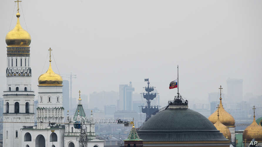 The Russian national flag is flown at half-mast on top of the Senate Building in the Kremlin on the day of national mourning in Moscow, Russia, Nov. 1, 2015.