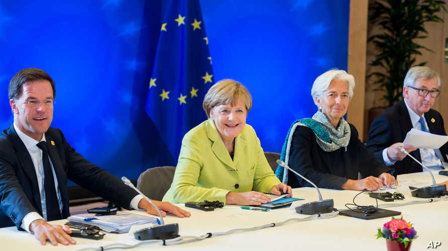 From left, Dutch Prime Minister Mark Rutte, German Chancellor Angela Merkel, Managing Director of the International Monetary Fund Christine Lagarde and European Commission President Jean-Claude Juncker participate in a meeting at an EU summit at the