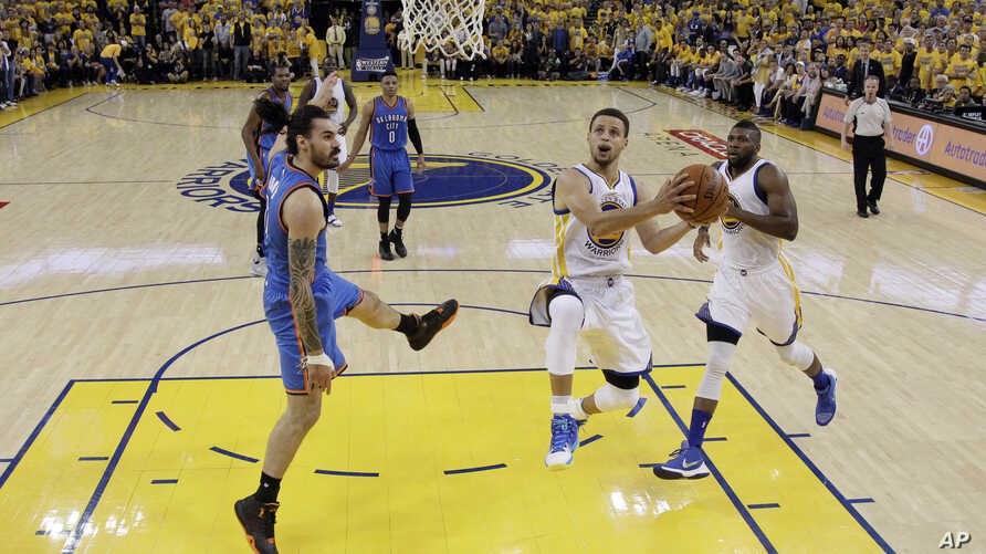 Golden State Warriors' Stephen Curry, center right, drives past Oklahoma City Thunder's Steven Adams, left, during the second half in Game 7 of the NBA basketball Western Conference finals Monday, May 30, 2016.