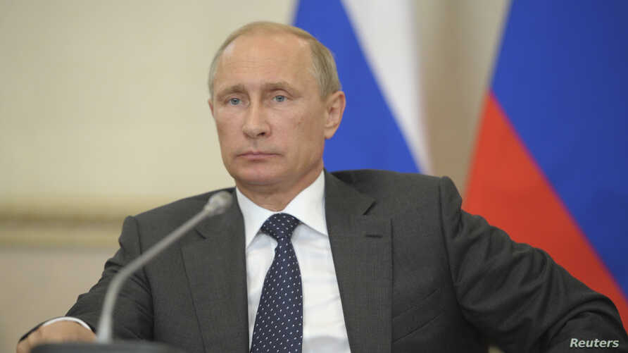 Russia's President Vladimir Putin chairs a session of the State Council Presidium in Voronezh, Russia, Aug. 5, 2014.