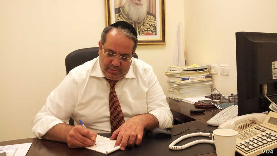 Israeli Knesset member Yigal Guetta works in an office in this undated Wikimedia photo.