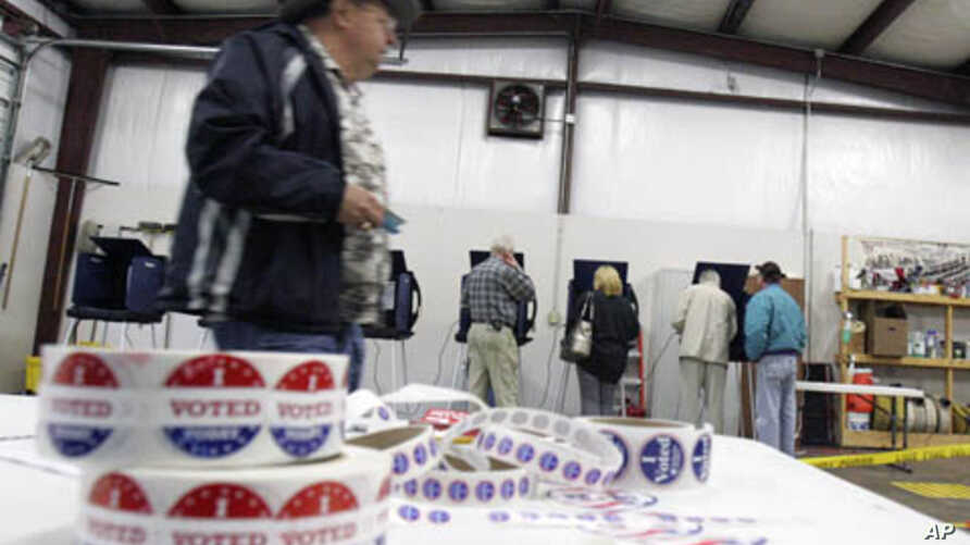 Voters cast ballots at Amick's Ferry Fire Station during the South Carolina presidential Primary in Chapin, South Carolina, January 21, 2012.