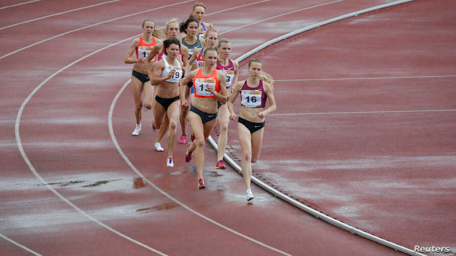 FILE - Russian runners compete in the women's 800 meters at the 58th Brothers Znamensky Memorial track and field meeting, June 4, 2016.