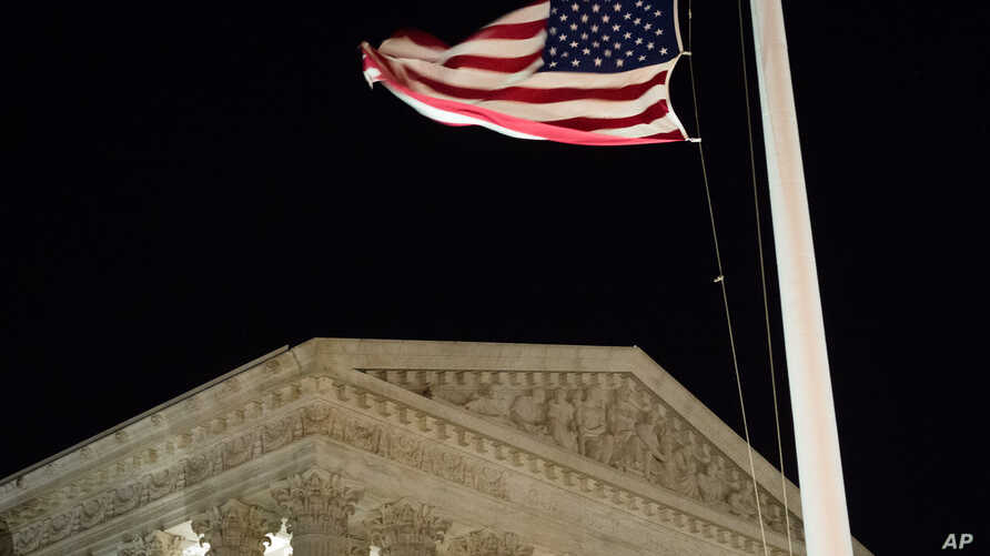 A U.S. flag flies at half-staff in front of the U.S. Supreme Court in Washington, Feb. 13, 2016, after is was announced that Supreme Court Justice Antonin Scalia, 79, had died.