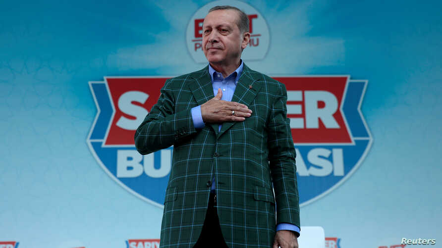 Turkish President Tayyip Erdogan gestures to his supporters during a rally for the upcoming referendum in Istanbul, Turkey, April 15, 2017.