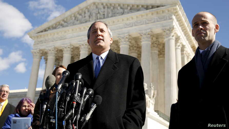 FILE - Texas Attorney General Ken Paxton addresses reporters on the steps of the U.S. Supreme Court in Washington, March 2, 2016.