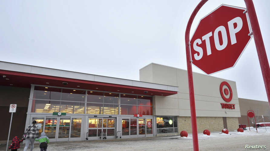 Target Corp. announced Thursday it would be closing all 133 stores in Canada; customers arrive at a Target store in St. Albert, Alberta, Jan. 15, 2015.