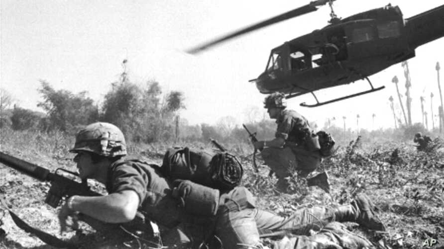 A U.S. helicopter climbs skyward after discharging a load of infantrymen in Vietnam.