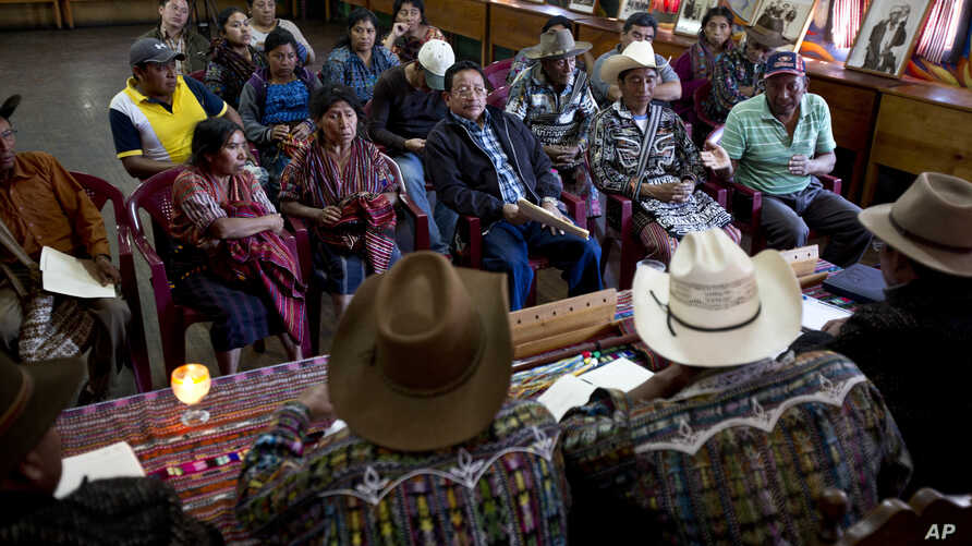 Residents listen to indigenous authorities acting as judges during a hearing related to a territorial limit conflict in their community, at the Indigenous City Hall in the Indian town of Solola, Guatemala, Jan. 16, 2017.