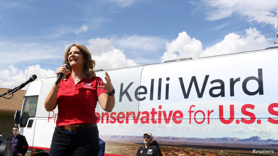 FILE - Kelli Ward campaigns at the Gunsite academy in her bid to become the Republican nominee for an open U.S. Senate seat in Paulden, Arizona, Aug. 24, 2018.