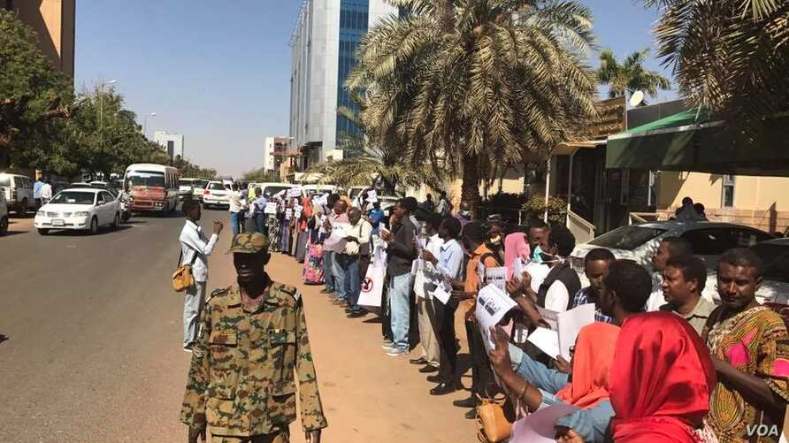 Protesting journalists line up outside the National Council for Press and Publications building in Khartoum, Sudan, Dec. 29, 2016.
