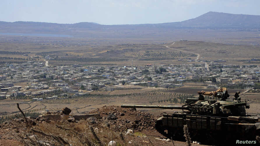A tank belonging to the forces loyal to Syria's President Bashar al-Assad is seen in the Quneitra city countryside on September 8, 2014 during a battle with rebels, near the border fence with the Israeli-occupied Golan Heights, in this picture releas