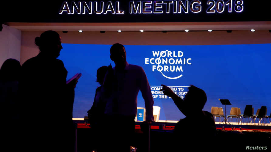 Staff talk in the Congress Hall ahead of the World Economic Forum (WEF) annual meeting in the Swiss Alps resort of Davos, Switzerland, Jan.  22, 2018.