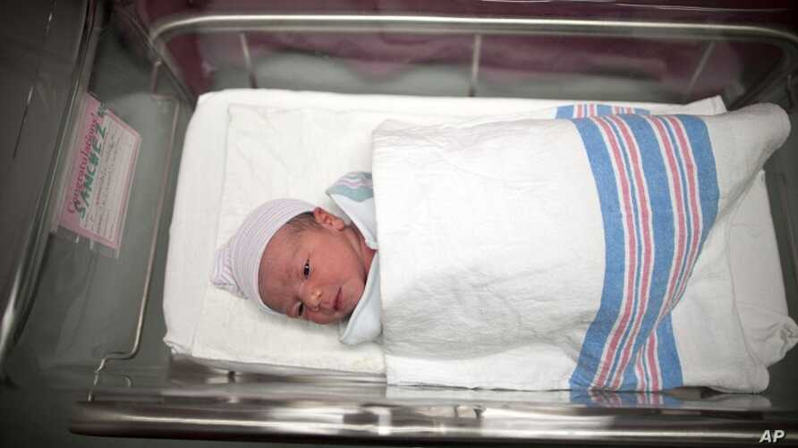 Newborn baby Makenzie, daughter of Stephanie Sanchez, 25, and Kenneth Vega, is wheeled to a nursery after she was born at 10:25am at Wyckoff Heights Medical Center in the Brooklyn borough of New York (October 2011 file photo)
