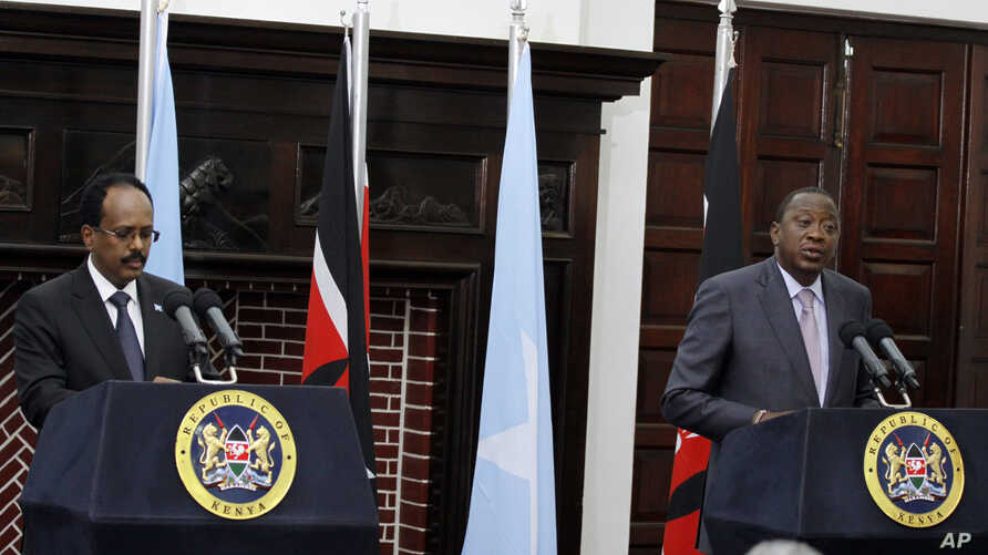Kenyan President Uhuru Kenyatta, right, speaks during a joint news conference with Somalia President Mohamed Abdullahi Mohamed at State House in Nairobi, Kenya, March 23, 2017.