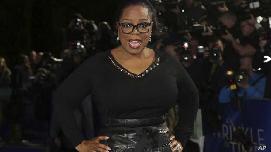 FILE - TV magnate and actress Oprah Winfrey poses for photographers upon arrival at the premiere of the film 'A Wrinkle in Time,' in London, Britain, March 13, 2018.
