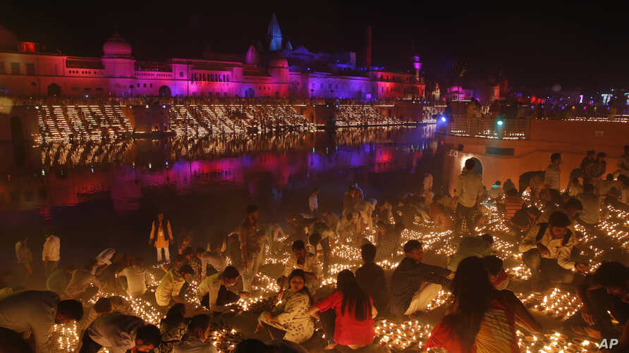 Devotees light earthen lamps on the banks of the River Sarayu as part of Diwali celebrations in Ayodhya, India, India, Tuesday, Nov. 6, 2018.