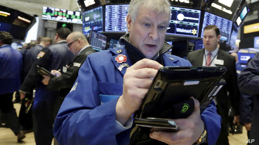 Trader Richard Newman works on the floor of the New York Stock Exchange, Feb. 7, 2018.