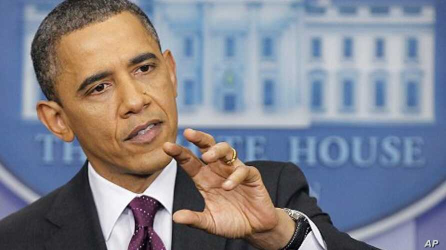 President Barack Obama gestures during a news conference at the White House, Tuesday, March 6, 2012.