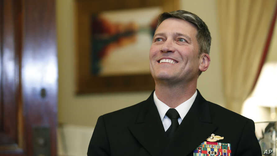 U.S. Navy Rear Admiral Ronny Jackson, M.D., sits with Sen. Johnny Isakson, R-Ga., chairman of the Veteran's Affairs Committee, before their meeting on Capitol Hill, April 16, 2018 in Washington. Jackson is President Donald Trump's nominee to be the n