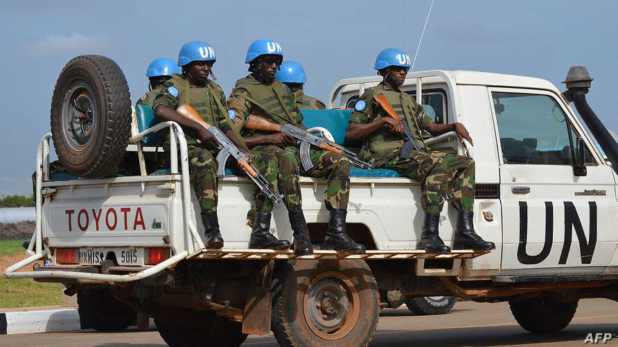 FILE - UN peacekeepers secure a section of the airport on August 12, 2014 as members of the United Nations Security Council arrive in the South Sudanese capital, Juba.