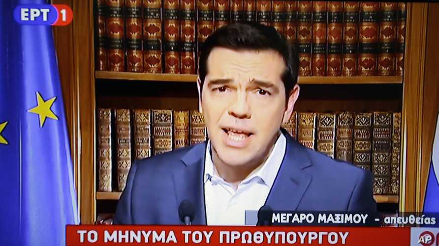 In this photo taken from television Greece's Prime Minister Alexis Tsirpas delivers a televised address to the nation from his office at Maximos Mansion in Athens, July 1, 2015. Tsipras has vowed to push on with his plan for a referendum this Sunday