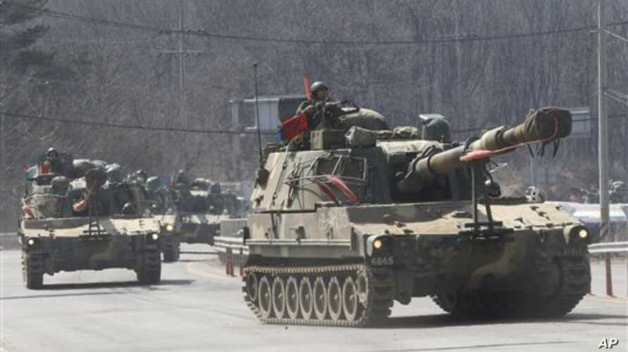South Korean army K-55 self-propelled howitzers move during an exercise against possible attacks by North Korea in Pocheon, South Korea, near the border with North Korea, Wednesday, March 27, 2013. North Korea said Wednesday that it had cut off a key