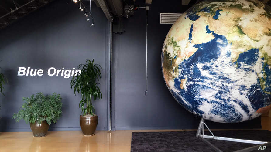 FILE - The lobby of space venture Blue Origin features a replica of the Earth, March 8, 2016, in Kent, Wash. On Wednesday, the company sent a capsule higher into space than it has ever done before.