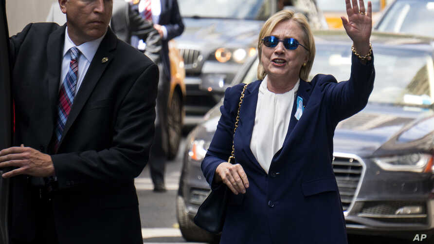 Democratic presidential candidate Hillary Clinton walks from her daughter's apartment building Sunday, Sept. 11, 2016.