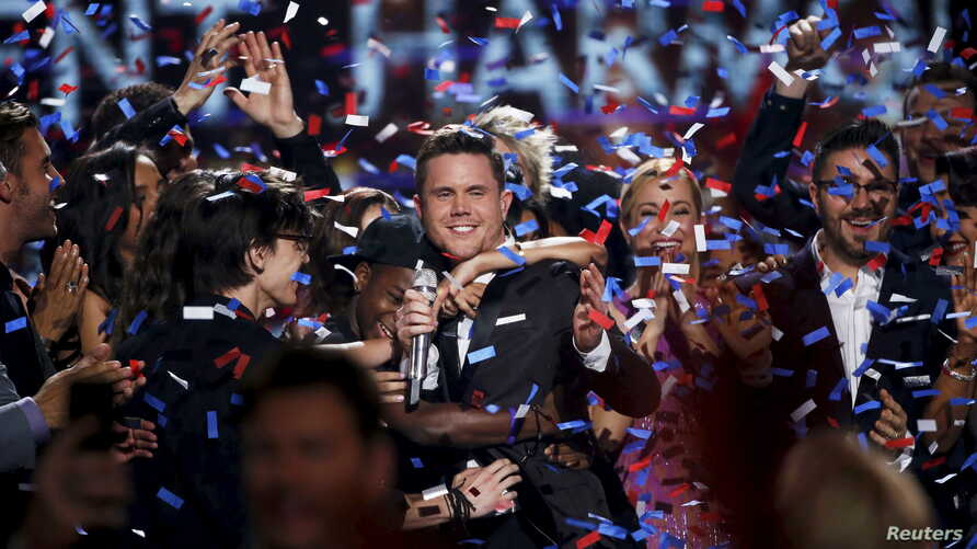 Singer Trent Harmon, the winner of the final season of 'American Idol', is congratulated during the show's Grand Finale in Hollywood, California, April 7, 2016
