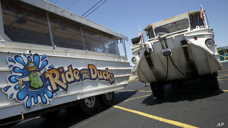 FILE - Duck boats sit idle in the parking lot of Ride the Ducks in Branson, Mo., July 21, 2018.